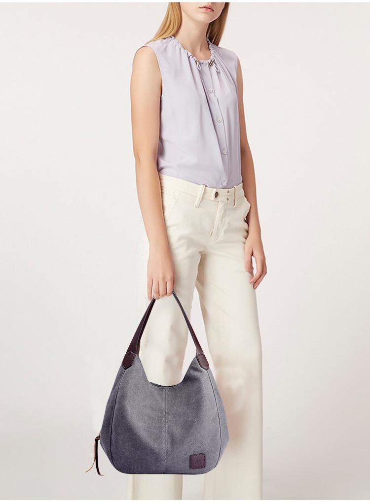 灰色帆布包模特手提展示