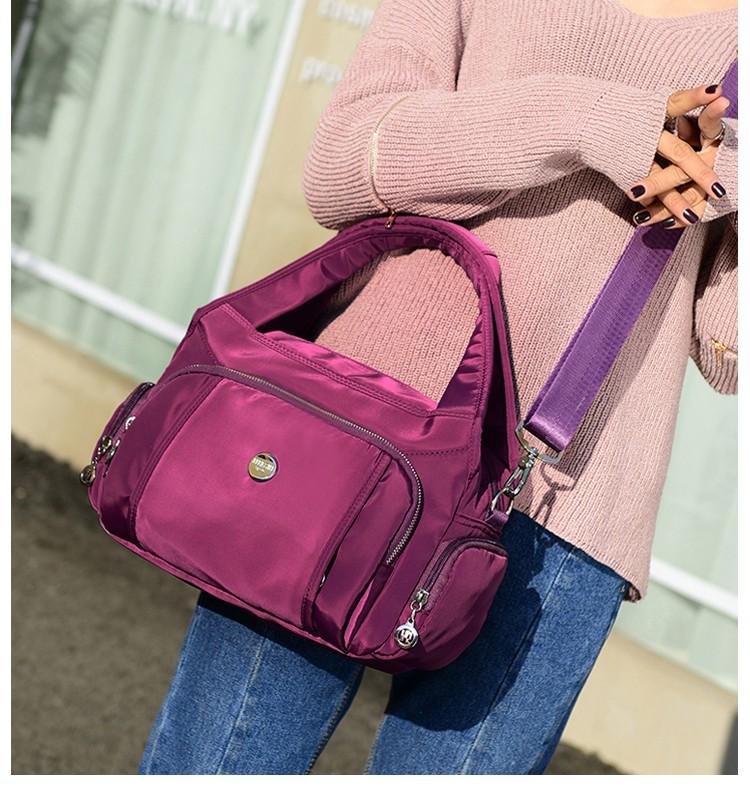 尼龍手提包單肩包紫色模特展示