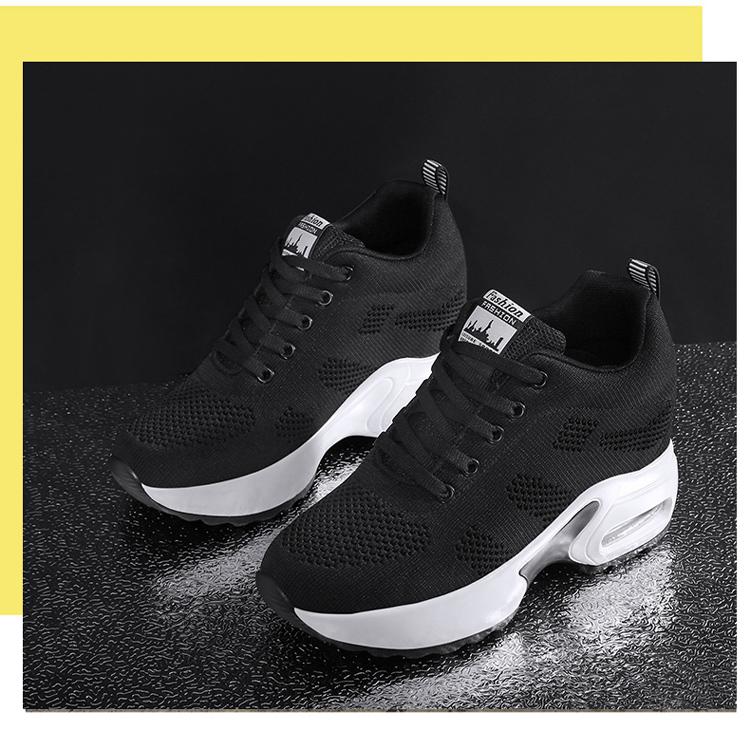 黑色氣墊運動鞋擺拍