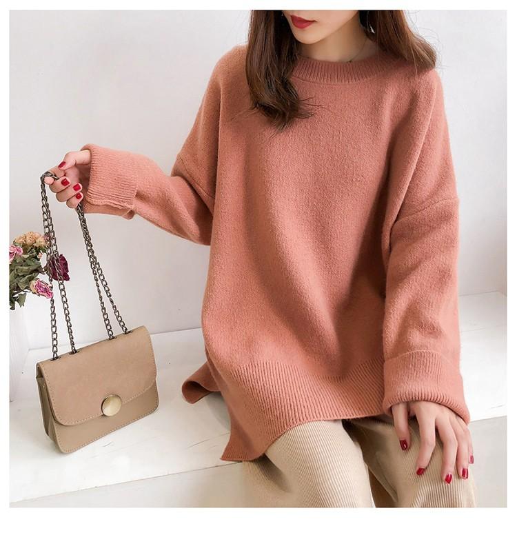 橘色針織毛衣模特展示